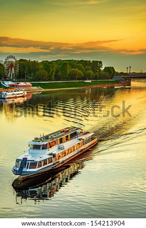 Motor ship at sunset sails on river Volga in Tver, Russia.