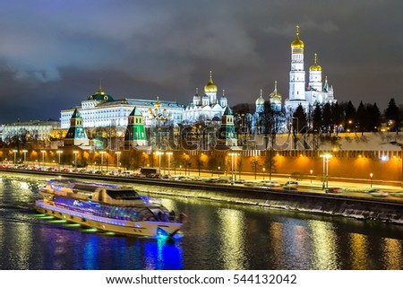 Motor ship on Moscow river and beautiful Kremlin blurry