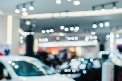 Motor show super car speed auto salon drive on modern store vehicle with new technology ecology power and traffic light shopping showroom with people abstract bokeh blur.