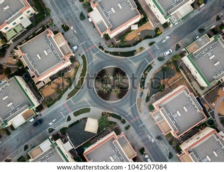 Motor vehicle roundabout from above #1042507084