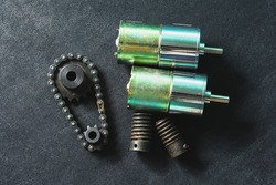 Motor, worm gear, drive sprockets and industrial driving roller chains. Vintage style photo.