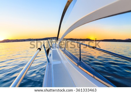 motor yacht at sunset