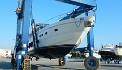 motor yacht is raised with a special crane for repair