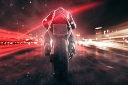 Motorbike drives through night city