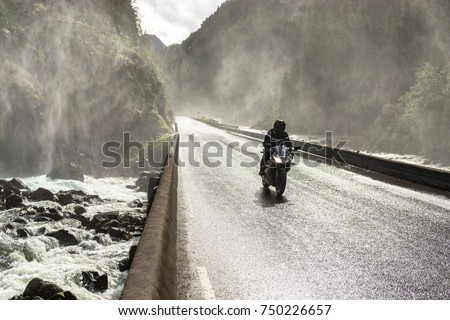 motorbike driving fast on wet...