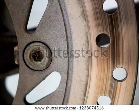 Motorbike engine disk brake. Close up of a motorcycle disk brake. #1238074516