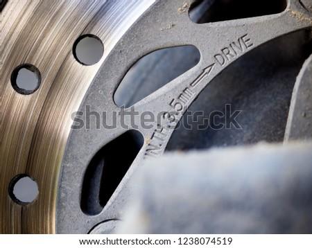 Motorbike engine disk brake. Close up of a motorcycle disk brake. #1238074519