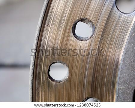 Motorbike engine disk brake. Close up of a motorcycle disk brake. #1238074525