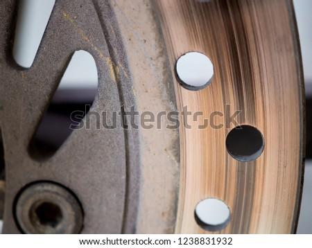 Motorbike engine disk brake. Close up of a motorcycle disk brake. #1238831932