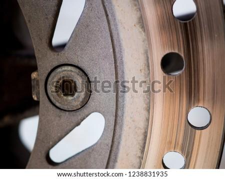 Motorbike engine disk brake. Close up of a motorcycle disk brake. #1238831935