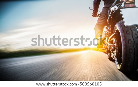 motorbike on the road riding. having fun driving the empty road on a motorcycle tour journey. copyspace for your individual text. - Shutterstock ID 500560105