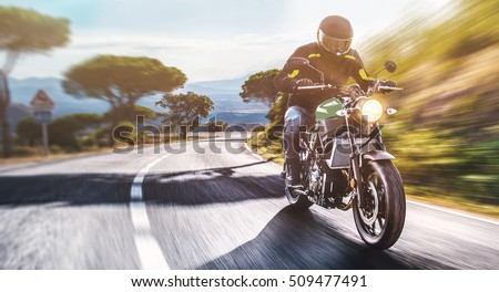 motorbike on the road riding. having fun driving the empty road on a motorcycle tour journey. copyspace for your individual text. #509477491