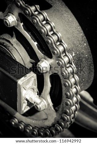Motorbike or Motorcycle chain. Great for abstract background or poster. Selective focus on chain. Creative Lighting.