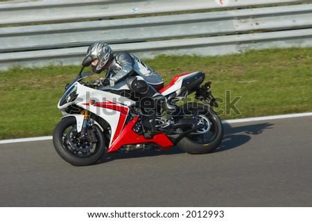 Motorbike racing in circuit