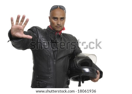 Motorbike rider with a stop gesture isolated against a white background