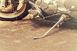 Motorbike wheel and leg closeup