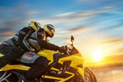 Motorbikers on sports motorbike riding in sunset. Outdoor photography, European landscape. Travel and sport photography. Speed and freedom concept