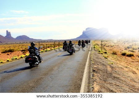 Motorbikers traveling in Monument Valley