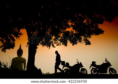 Motorbikes silhouette and sunrise at The Biggest Buddha statue, Wat Muang Ang thong temple in Thailand #422236930