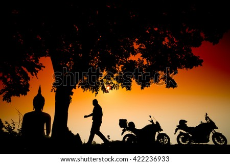 Motorbikes silhouette and sunrise at The Biggest Buddha statue, Wat Muang Ang thong temple in Thailand #422236933