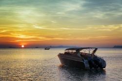Motorboat at sunset. Beautiful landscape.