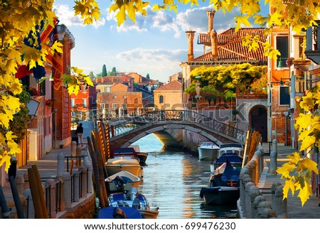 Shutterstock Motorboats and old houses in Venice, Italy