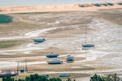 Motorboats at low tide in Bassin d'Arcachon - Cap Ferret, Aquitaine, France