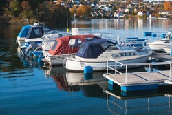 Motorboats moored in Norwegian town at sunny day. Levanger, Norway