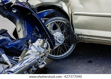 Motorcycle accident with a car. #427377040