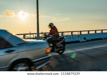 motorcycle and car in motion blur for motion effect #1518879239
