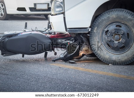 Motorcycle and truck head-on accident. #673012249