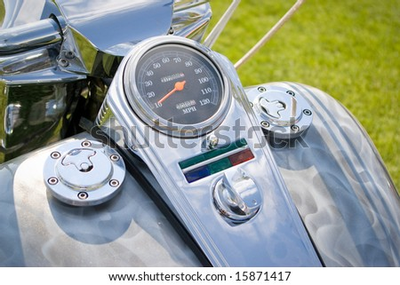 motorcycle chrome dashboard with speedometer in orange