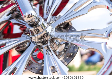 Motorcycle close-up. Detail of a beautiful powerful chrome motorcycle wheels. The concept of freedom and travel. custom works. Metallic shiny new internal combustion engine