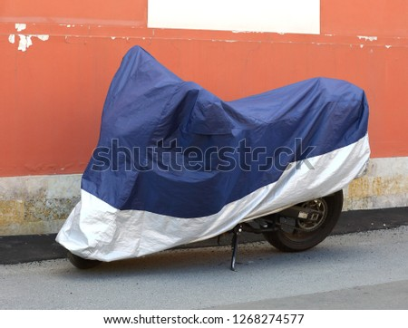 Motorcycle covered with a cover #1268274577