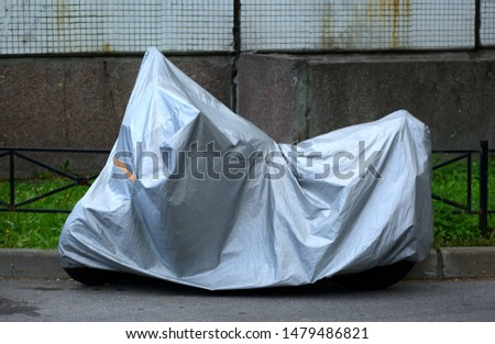 Motorcycle covered with a cover #1479486821