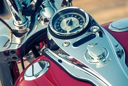 Motorcycle detail with gasoline tank and speedometer. Chrome motorcycle details closeup.