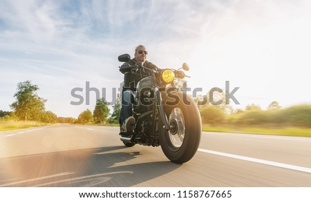 Motorcycle driver riding cruiser on the highway, central Europe. #1158767665