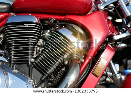 Motorcycle engine close-up background. The bike glistens in the sun.