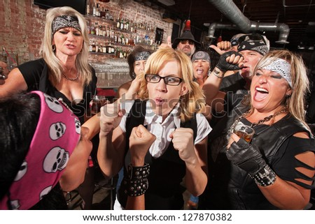 Motorcycle gang members force a fight with nerd in bar