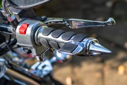 Motorcycle handlebar chromed grips with black rubber. Throttle assist bar ends for hand grips.