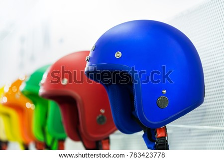 Motorcycle helmets hanging on the wall.