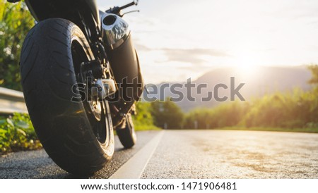 motorcycle in a sunny motorbike on the road riding.with sunset light. copyspace for your individual text.