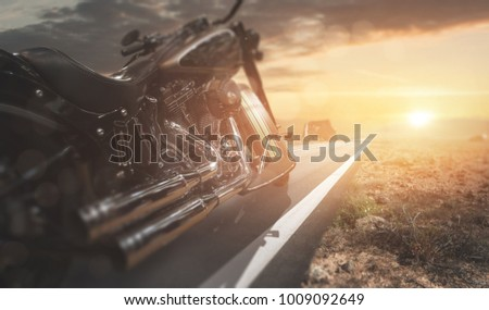 Motorcycle on a country road #1009092649