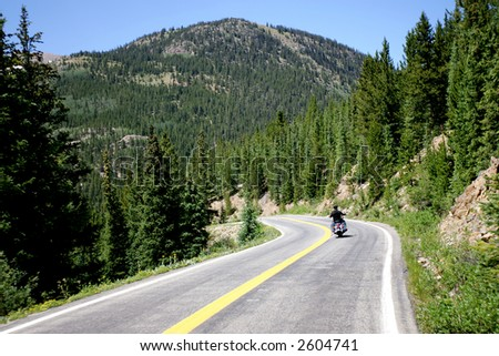 Motorcycle Rider on Mountain Road in Colorado