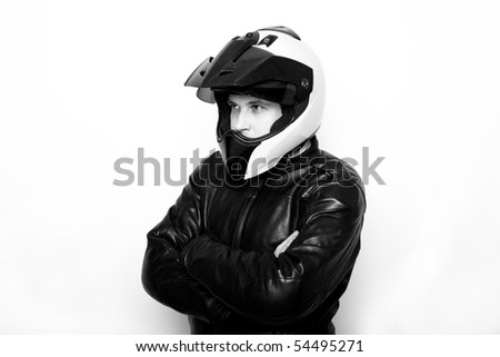 Motorcycle rider with worn out enduro helmet and leather jacket