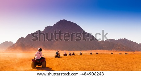 Motorcycle safari in land Egypt. People riding travel. Beautiful holiday background. Extreme hobby games.  Speed achievement tracking. Amazing desert Sharm. Adrenalin speed.  Stock photo ©