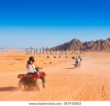 Motorcycle safari in the land Egypt. People travel. Beautiful  holiday background. Extreme hobby games.  Speed achievement tracking. Amazing desert Sharm.