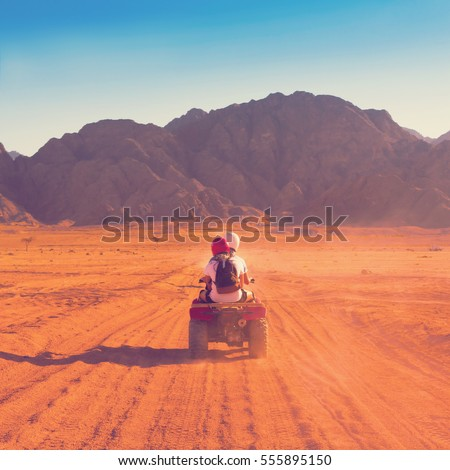 Motorcycle safari in the land Egypt. People travel. Beautiful  holiday background. Extreme hobby games.  Speed achievement tracking. Amazing desert Sharm Stock photo ©