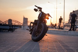Motorcycle stay at the parking under rays of sunset