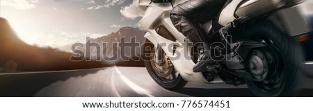 Motorcycle tour in a mountain landscape #776574451